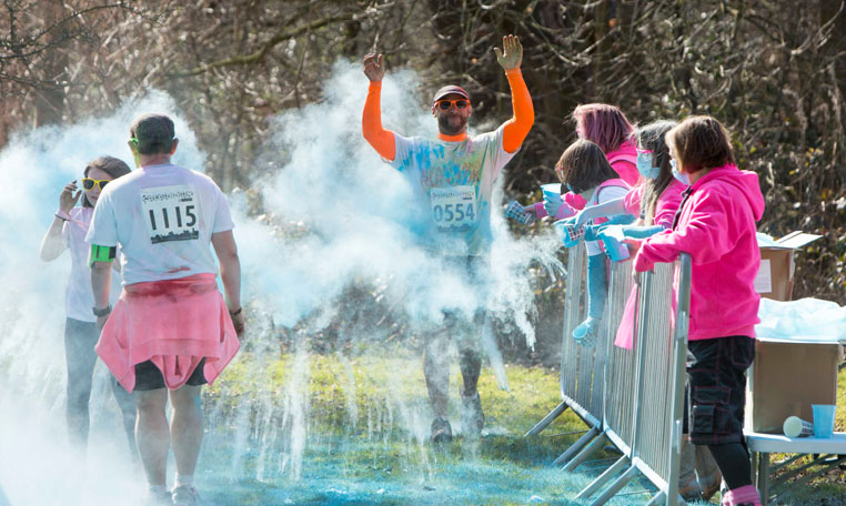 Spectators join the action from behind crowd control barriers at the St Annes Hospice colour fun run