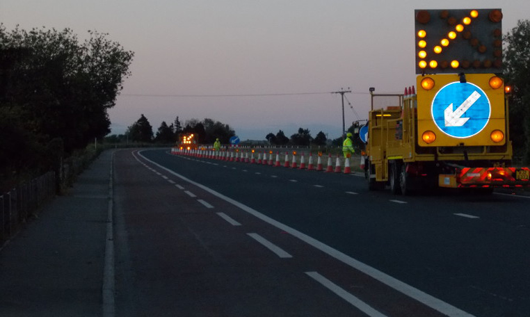 Operatives safely carry out roadworks thanks to a well lit vehicle helping to manage traffic at high speed