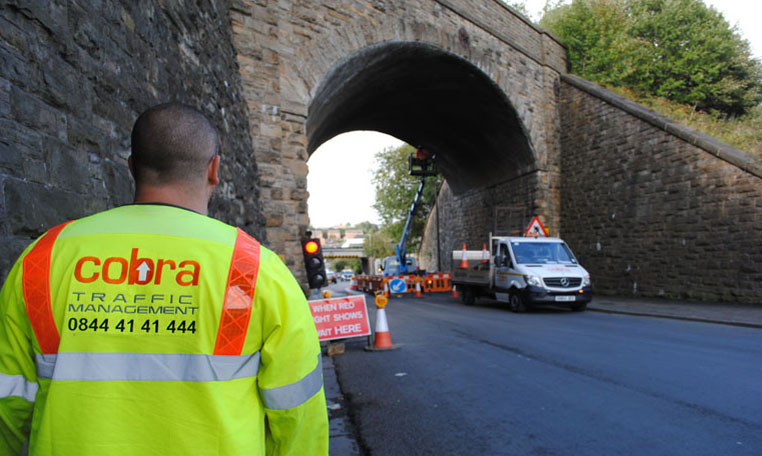 Cobra traffic management provide temporary traffic signals and safely secure a working area for a bridge repair