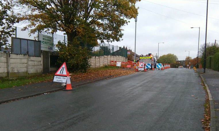 Signs and cones are used to manage traffic around street works